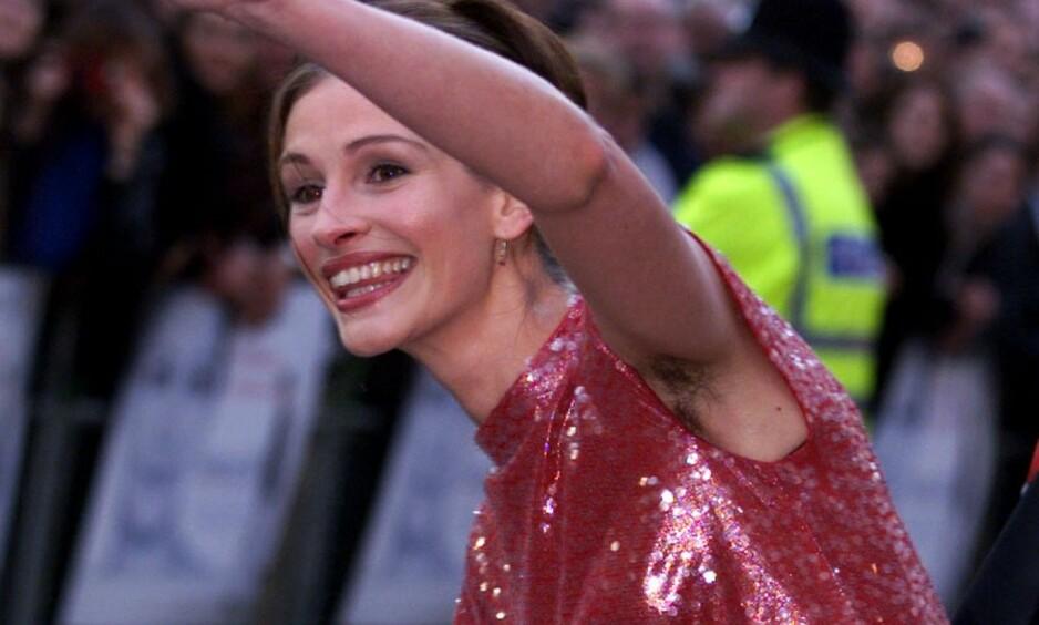 BLE HYLLET: I 1999 vekket skuespillerstjerna oppsikt da hun møtte opp på rød løper med hår under armene. I et nytt intervju forklarer hun at det hele egentlig var en kjoletabbe. Foto: NTB scanpix