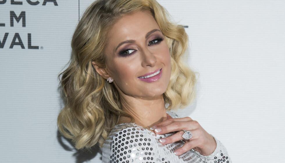 SINGEL IGJEN: Paris Hilton er ikke lenger forlovet, og kan se seg nå nødt til å ta av den flotte forlovelsesringen. Foto: NTB Scanpix