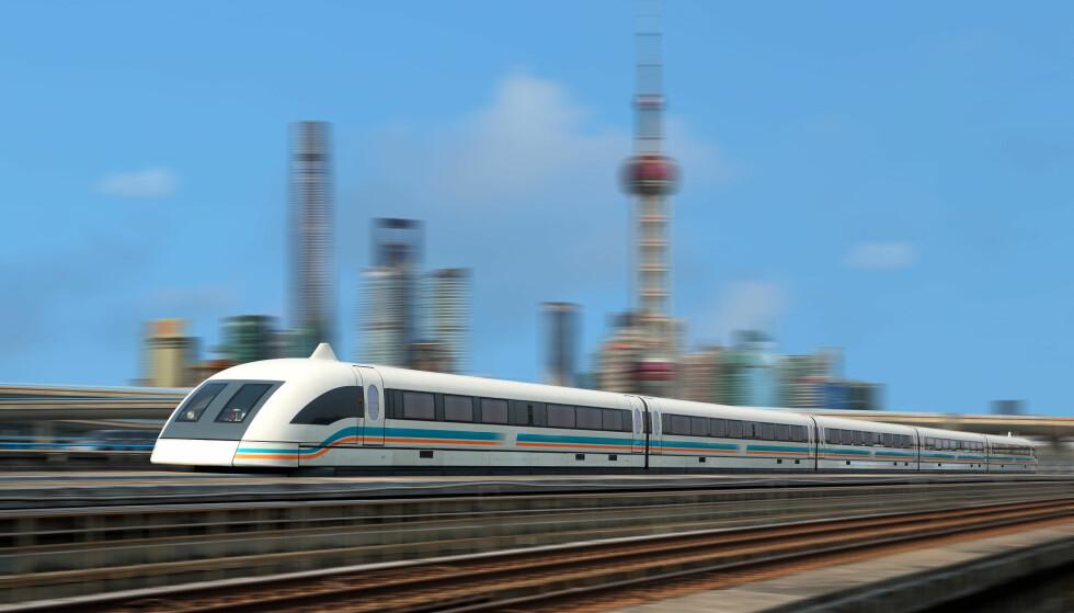 430 KM/T: Flytoget i Shanghai kjører den tre mil lange strekningen inn til byen på litt over sju minutter. Foto: NTB Scanpix