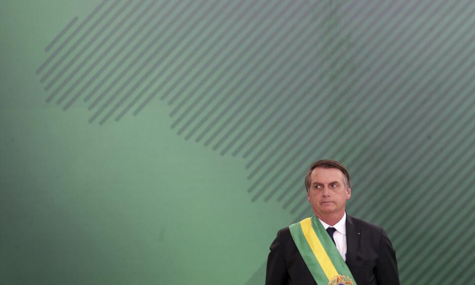 ÅPNINGSTALE: Brasils nye president Jair Bolsonaro holder tirsdag åpningstalen under World Economic Forum i Davos i Sveits. Populisten gikk til valg på løfter om å bekjempe korrupsjon og gjenopprette lov og orden. I Davos varsler han at det er et nytt Brasil som entrer arenaen. Foto: Eraldo Peres / AFP / NTB Scanpix