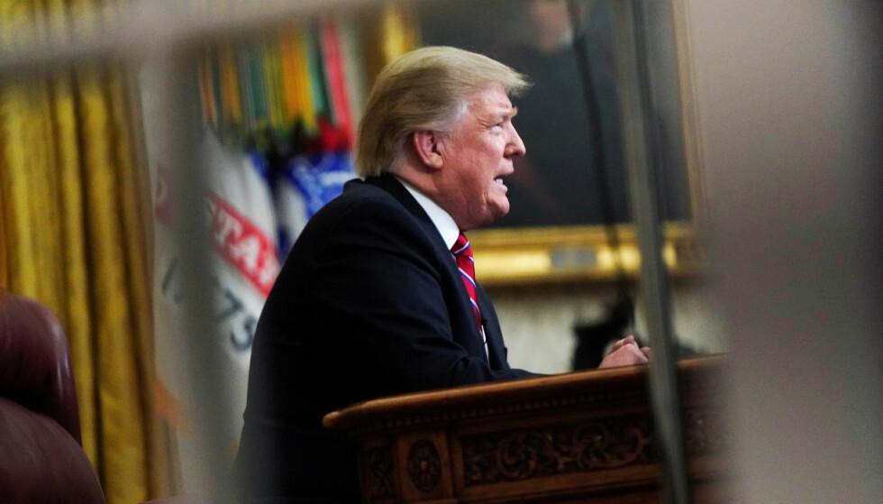 HJEMME: USAs president Donald Trump har holdt seg hjemme fra Verdens Økonomiske Forum i Davos, som følge av den pågående budsjettkrangelen i USA. Foto: Joshua Roberts / Reuters / NTB Scanpix
