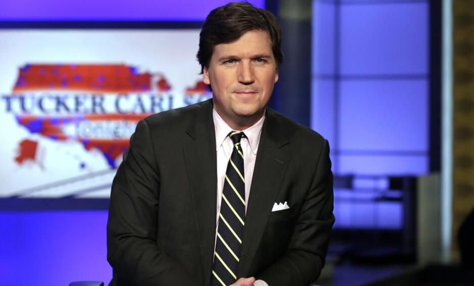 KONSERVATIV VEIVISER: Tucker Carlson er et kjent ansikt for dem som følger Fox News, og han bruker sin posisjon også til å være en konservativ veiviser for det republikanske partiet. Foto: NTB Scanpix