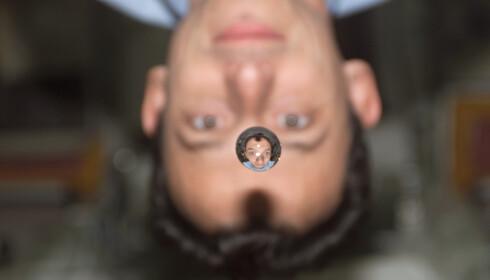DRÅPE: Den spanske astronauten Pedro Duque speiles i en vektløs vanndråpe. Foto: Nasa.