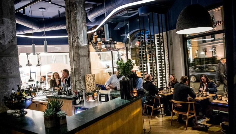 POPULÆRT: Vinoteket i Henrik Ibsens gate byr på et bredt utvalg vin og et kuriøst utvalg pizza. Foto: Christian Roth Christensen