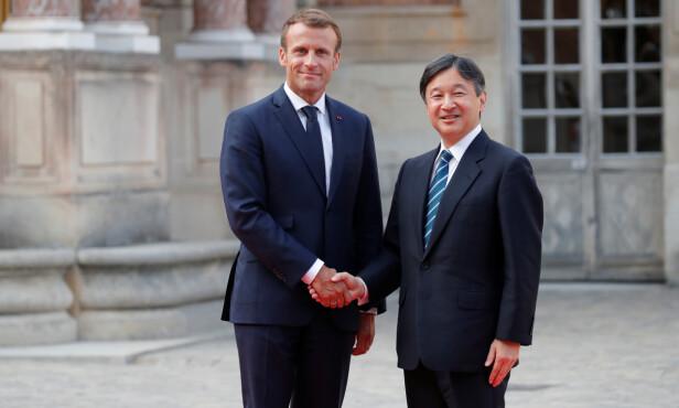 KEISERLIGE PLIKTER: Kronprinsen har de siste åra tatt over enkelte av farens oppgaver. Her besøker han Frankrikes president, Emmanuel Macron, i 2018. Foto: NTB Scanpix