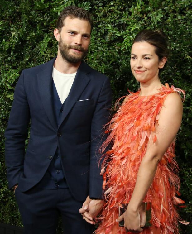 GIFT: Jamie Dornan og Amelia Warner ga hverandre sitt ja i 2013, og har to barn sammen. Foto: NTB Scanpix
