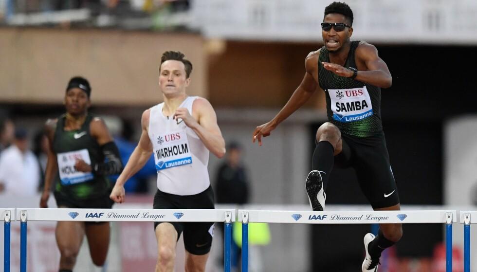 SUPERDUELLEN: Karsten Warholm mot Abderrahman Samba er i ferd med å bli en av friidrettens største gigantdueller. Foto: AFP PHOTO / Alain GROSCLAUDE