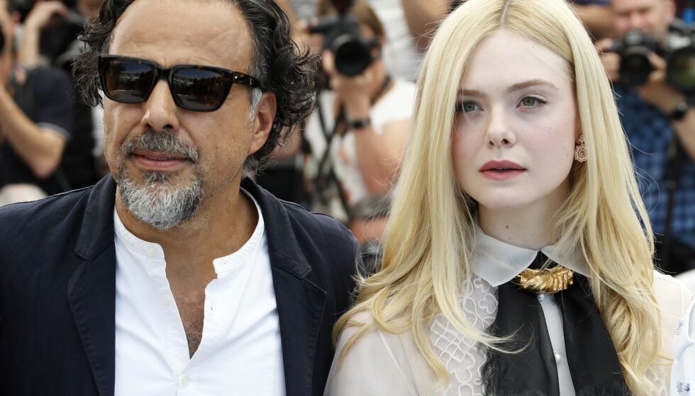 GJENFORENT: Regissør Alejandro González Iñárritu ga Elle Fanning hennes første filmrolle, da hun var syv år gammel. Nå sitter hun i juryen under filmfestivalen i Cannes, som regissøren leder. Foto: Eric Gaillard / Reuters / Scanpix