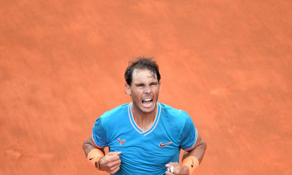 SEIER: Rafael Nadal feirer etter gullet i Roma. Foto: Tiziana FABI / AFP