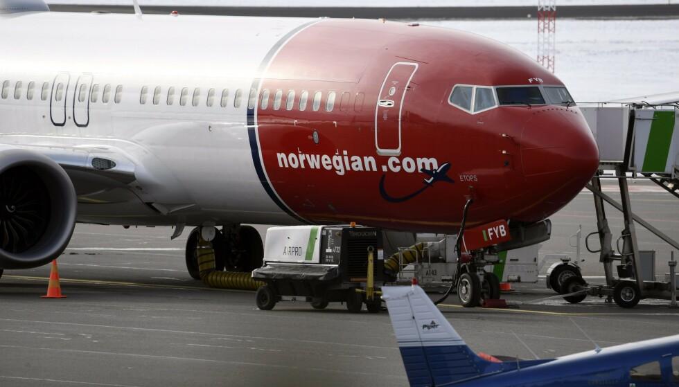PÅ UBESTEMT TID: Dette Norwegian-flyet av typen Boeing 737 Max befant seg på Vantaa-flyplassen ved Helsinki, da det i mars i år ble tatt ut av trafikk. Foto: Heikki Saukkomaa/NTB Scanpix