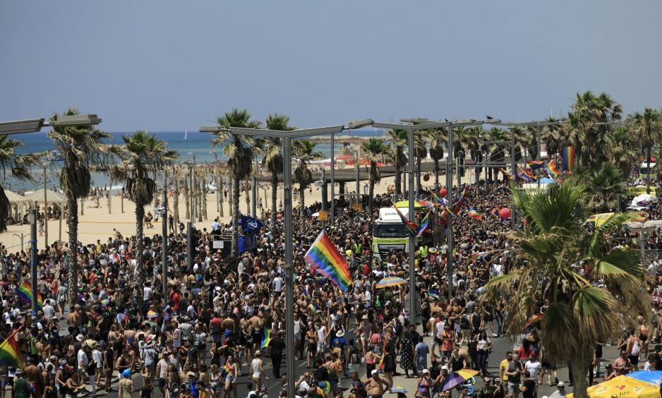 <strong>REKORD:</strong> Det ble rekordstort oppmøte under den årlige Gay Pride-paraden i Tel Aviv fredag. Foto: Tsafrir Abayov / AP / NTB scanpix