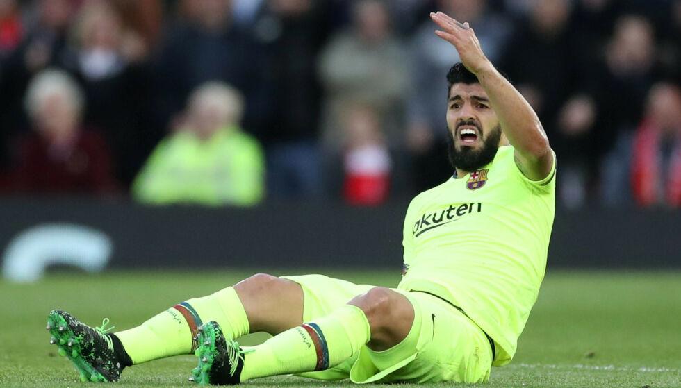 TUNG DAG: Luis Suarez og Barcelona røyk ut av Champions League mot Liverpool. Reuters/Carl Recine