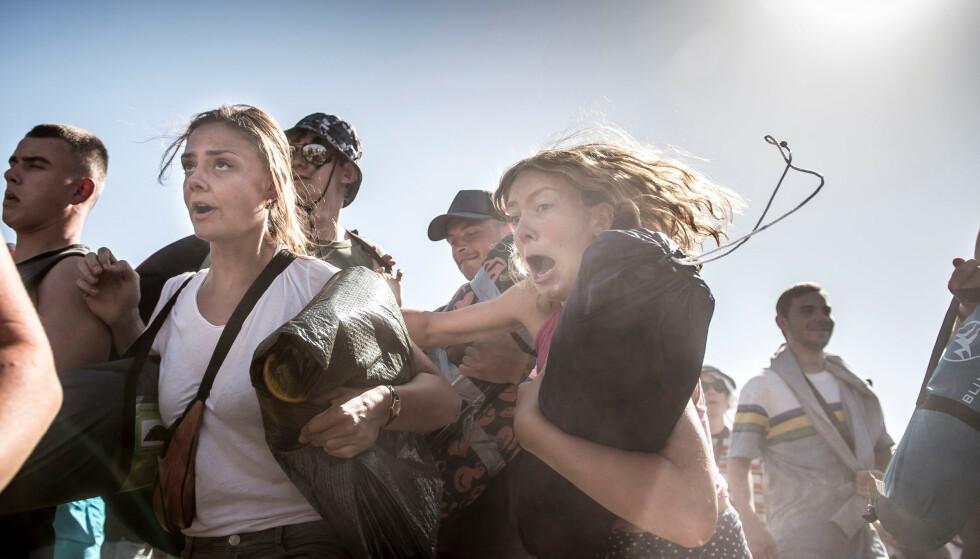 KAPPLØP: Det er fullt kjør når Roskilde-festivalen åpner dørene for tusenvis av festivalgjester. Her fra innslippet i år, der det nok en gang var kappløp for å sikre seg de beste campingplassene. Foto: Mads Claus Rasmussen/Ritzau Scanpix