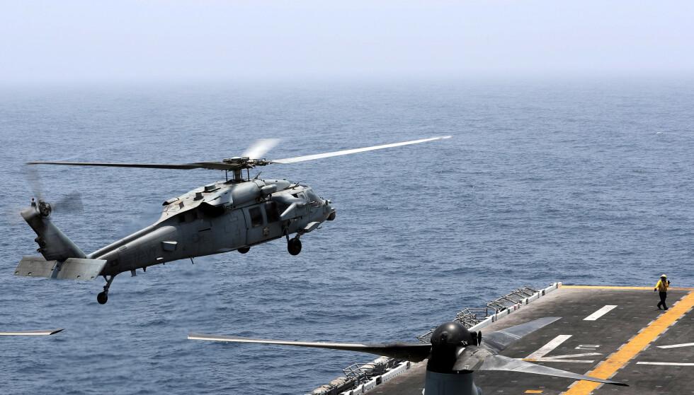 I SKUDDLINJEN: Hangarskipet USS Boxer har havnet i den verbale skuddlinjen mellom USAs president Donald Trump og Irans utenriksdepartement. Foto: Ahmed Jadallah / Reuters / NTB Scanpix