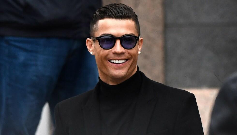 JAKTER TRE JENTER: Cristiano Ronaldo vil betale tilbake en gammel «gjeld». Foto: NTB Scanpix