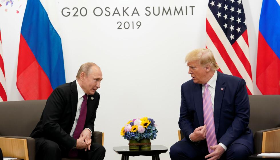 LEDENDE FIGURER I VÅR TID: Russlands president Vladimir Putin og USAs presiden Donald Trump. Her under G20-møtet tidligere i sommer. Foto: Mikhail Klimentyev / SPUTNIK / AFP Photo / NTB scanpix