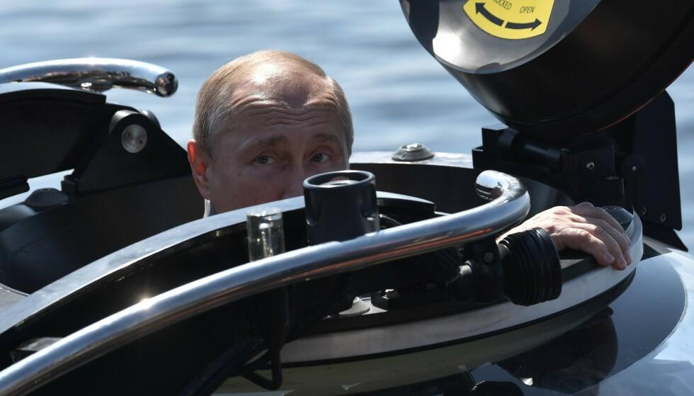 FRYKTES: 2 av 3 nordmenn mener mener Vladimir Putin og Russland kan utgjøre en trussel for verdensfreden. Foto: Aleksej Nikolskij / Sputnik / AFP / NTB Scanpix