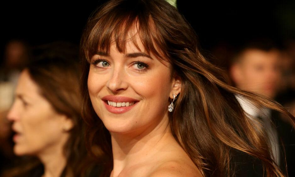 VAREMERKE: Skuespiller Dakota Johnson er kjent for sitt karakteristiske mellomrom mellom tennene. Foto: NTB Scanpix