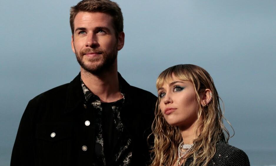 BRUDD: Åtte måneder etter at de ble erklært mann og kone, gikk Liam Hemsworth og Miley Cyrus hver til sitt. Siden har det vært relativt taust fra de begge, men nå slår sistnevnte tilbake mot de mange ryktene som har florert etter skilsmissenyheten. Foto: NTB Scanpix