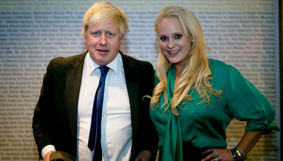 VENNER: Boris Johnson og Jennifer Arcuri omtaler seg selv som gode venner. Johnson skal blant annet ha besøkt hennes leilighet flere ganger da hun bodde i London. Nå kan statsministeren havne i hardt vær på grunn av offentlig pengestøtte Arcuri mottok. Foto: Rex / NTB Scanpix