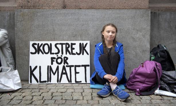 DEN SPEDE STARTEN: For et drøyt år siden aksjonerte Greta Thunberg alene utenfor Riksdagen i Stockholm. Foto: Jessica Gow/TT Nyhetsbyrån / NTB scanpix