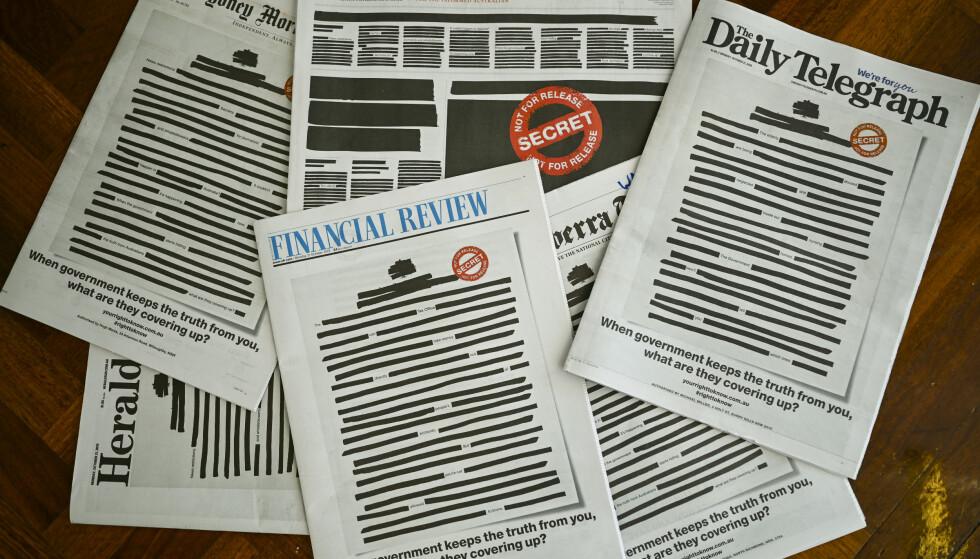 SLADDET: Forsidene til flere av de største australske aviser mandag 21. oktober, i en felles aksjon kalt «Your Right to Know», i en protest mot mindre pressefrihet. Foto: AAP Image / Lucas Coch / NTB scanpix