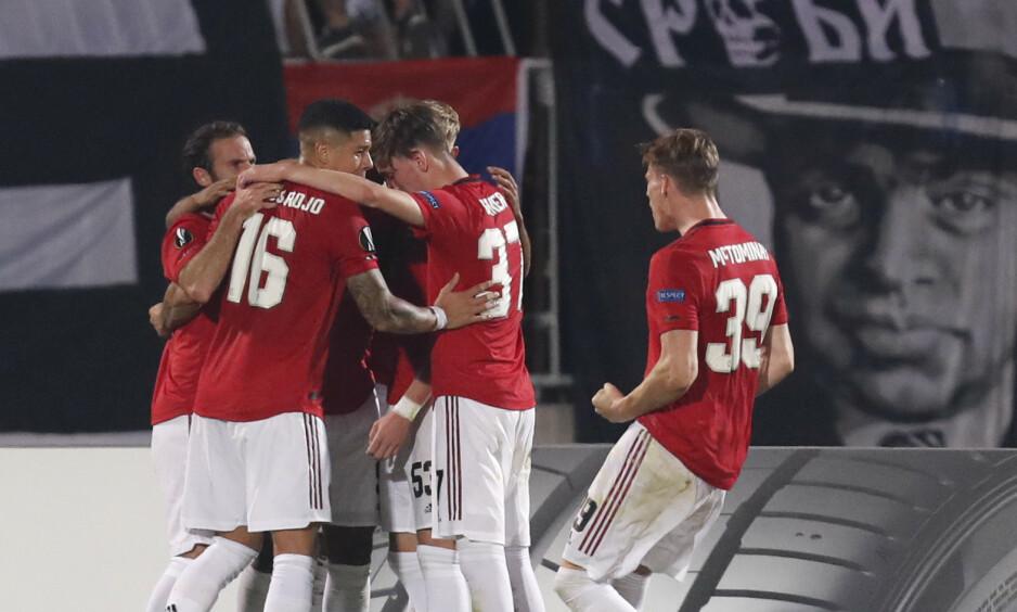 ENDELIG: United-spillerne kunne juble for en etterlengtet borteseier. Foto: Darko Vojinovic/AP/NTB Scanpix