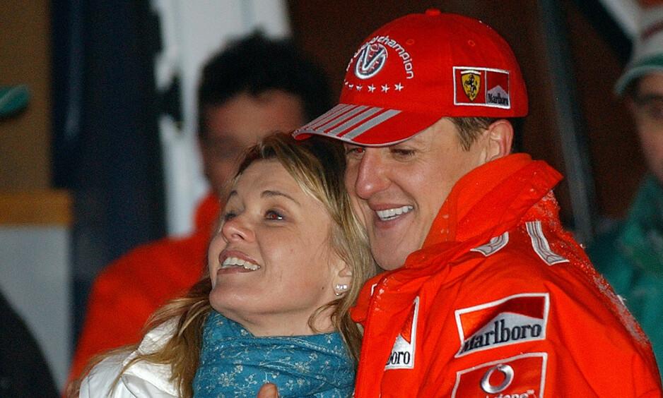 MANN OG KONE: Corinna og Michael Schumacher, her fra da sistnevntes karriere var på topp. Foto: Alberto Pellaschiar / AP Photo / NTB Scanpix