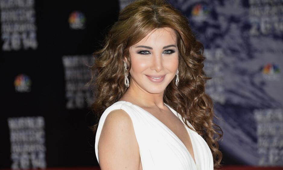 DRAMATISK: Søndag morgen ble den libenesiske superstjerna Nancy Ajram utsatt for et innbrudd i villaen sin i Beirut, Libanon. Inntrengeren ble møtt av stjernas ektemann som skjøt og drepte ham. Nå er det satt i gang en etterforskning av hendelsen, melder flere medier. Her er Ajram avbildet i 2014. Foto: NTB Scanpix