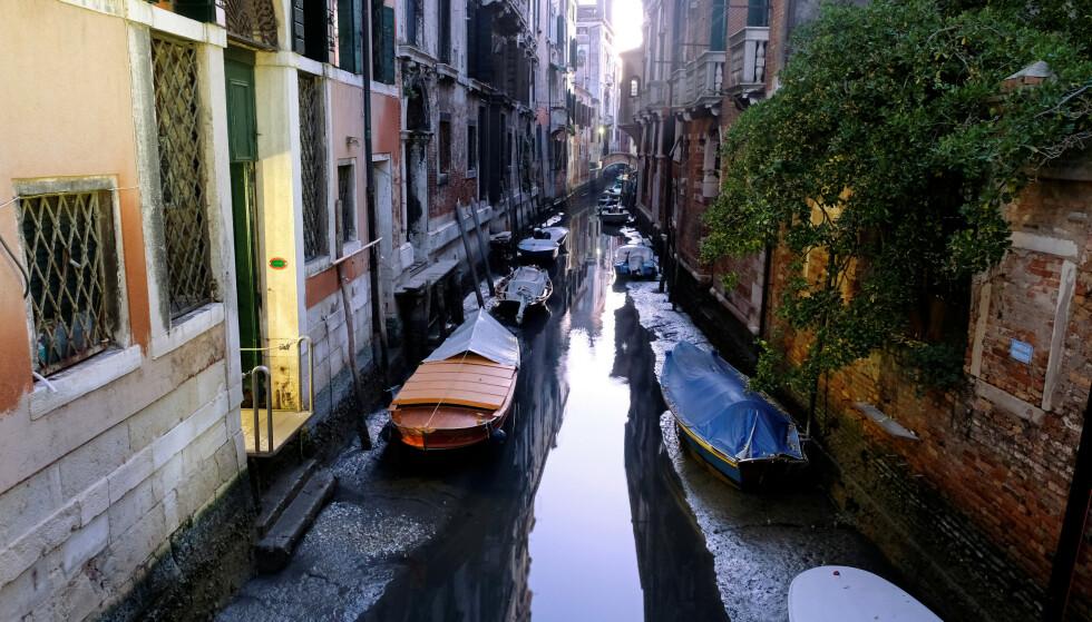 TØRRLAGT: Tidevannet var lavt i Venezia denne helga. Foto: NTB Scanpix