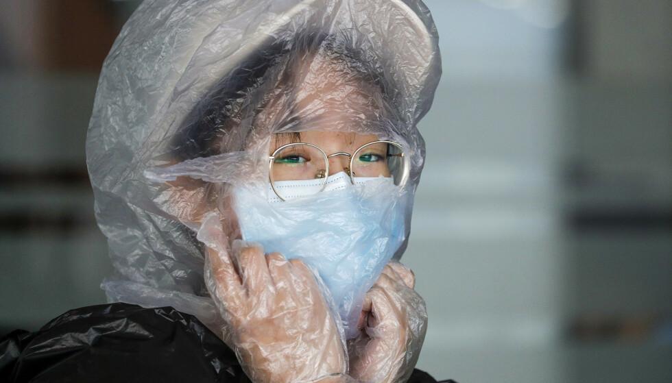 VANLIG SYN: I asiatiske land, som Japan og Kina, er bruk av munnbind utbredt. Foto: AP Photo / Aaron Favila / NTB scanpix