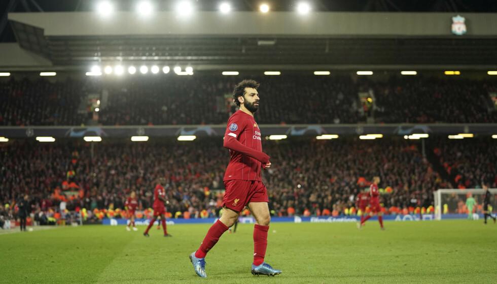 RØK: Liverpool og superstjerna Mohamed Salah røk ut av Champions League. Så startet coronakrisa for alvor. Nå er det uklart når turneringen starter opp igjen. Foto: AP Photo/Jon Super