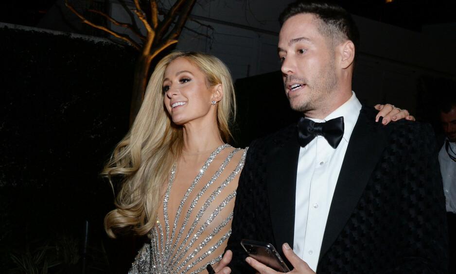 LYKKELIG FORELSKET: Første gang Paris Hilton ble sett med sin nye kjæreste Carter Reum var under årets Golden Globe Awards. Foto: NTB Scanpix