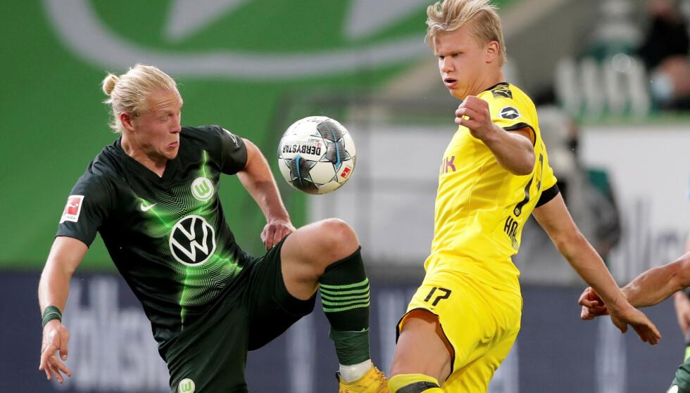 SATT PÅ PRØVE: Erling Braut Haaland og Dortmund fikk tre poeng, men Xaver Schlager ga dem knallhard kamp. Foto: NTB Scanpix