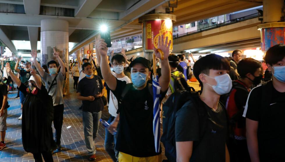 DEMONSTRASJONER: I helga har det vært en protestmarsj i Hong Kong mot den nye sikkerhetsloven Folkerepublikken Kina har foreslått å innføre. Foto: Tyrone Siu / Reuters / NTB scanpix