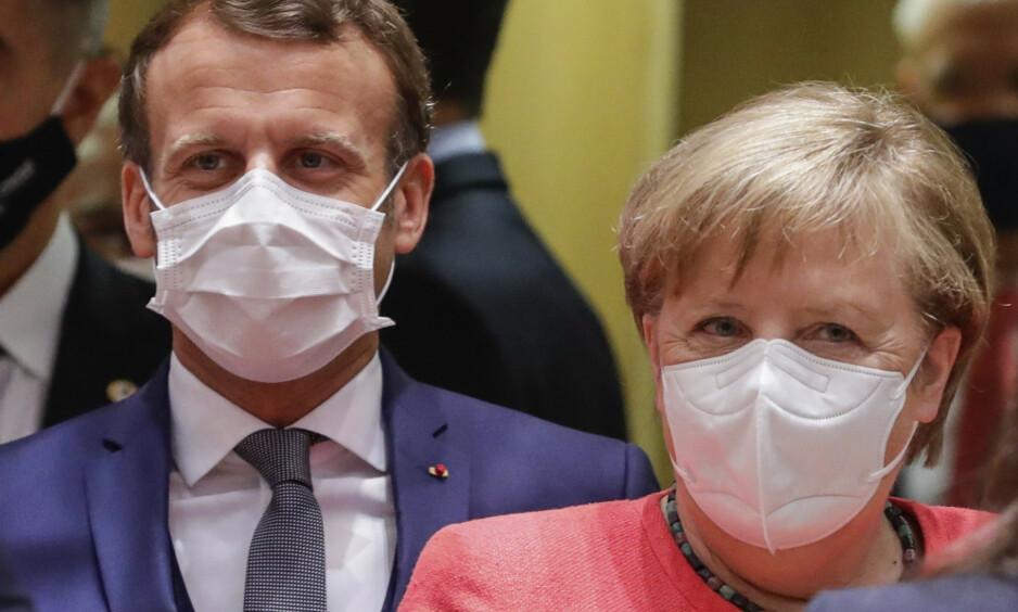 VINNERE: Emmanuel Macron, som fra han ble president har ivret for et sterkere EU, er nok den som kan være mest fornøyd etter helgas EU-toppmøte. Men uten full støtte fra Angela Merkel hadde det historiske forliket aldri kommet i havn. Foto: Stephanie Lecocq / AP / NTB Scanpix