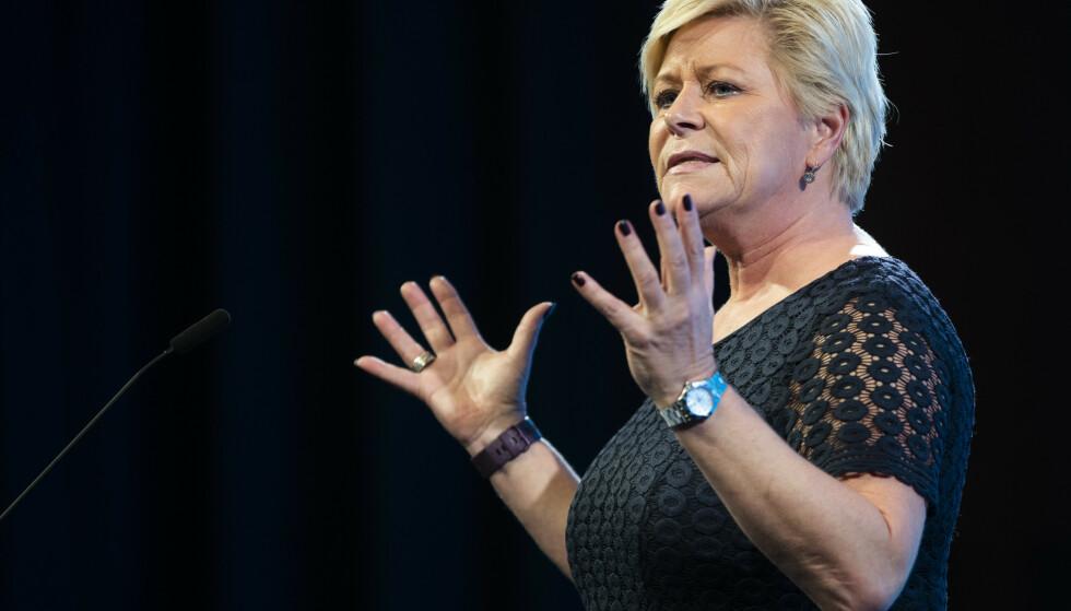 LANDSMØTETALE: Partileder Siv Jensen på talerstolen under Fremskrittspartiets landsmøte på Gardermoen. Foto: Berit Roald / NTB