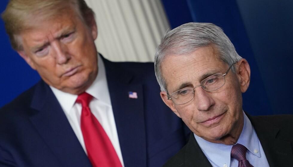 April: President Donald Trump og Dr. Anthony Fowzie på en pressekonferanse i Det hvite hus i april.  Foto: Mandel NGN / AFP