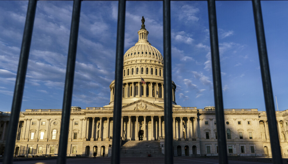 The Capitol is seen through a security barrier on the morning of Election Day, Tuesday, Nov. 3, 2020, in Washington. (AP Photo/J. Scott Applewhite)