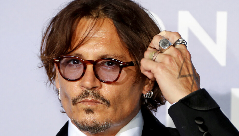 BEDT OM Å GÅ: Johnny Depp skriver fredag kveld at han fikk beskjed om å trekke seg fra kommende film. Foto: REUTERS/Eric Gaillard/Pool/ NTB