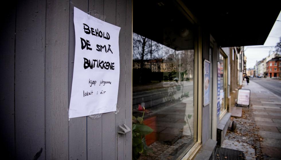 BUDSKAP: Behold Oslo vil at kundene skal ta vare på de små butikkene på Grünerløkka. Foto: Lars Eivind Bones / Dagbladet