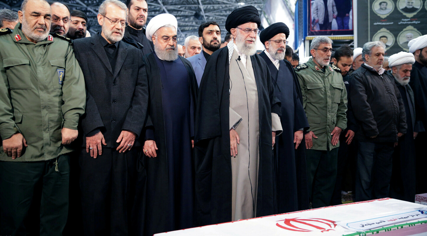 Iran's Supreme Leader Ayatollah Ali Khamenei and Iranian President Hassan Rouhani pray near the coffin of Iranian Major-General Qassem Soleimani, head of the elite Quds Force, who was killed in an air strike at Baghdad airport, in Tehran, Iran, January 6, 2020. Official President's website/Handout via REUTERS ATTENTION EDITORS - THIS IMAGE WAS PROVIDED BY A THIRD PARTY. NO RESALES. NO ARCHIVES     TPX IMAGES OF THE DAY