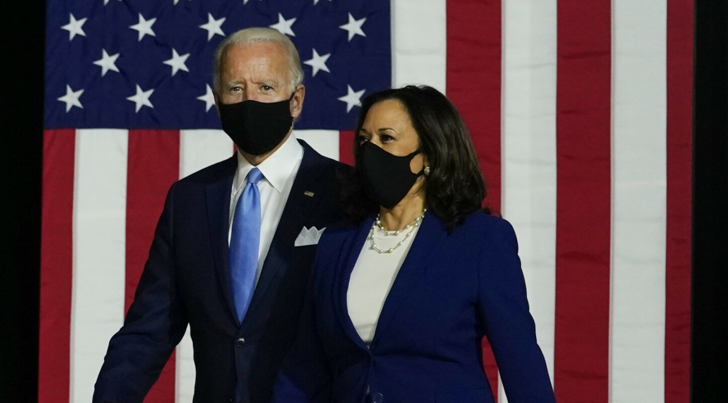 Democratic presidential candidate former Vice President Joe Biden and his running mate Sen. Kamala Harris, D-Calif., arrive for a campaign event at Alexis Dupont High School in Wilmington, Del., Wednesday, Aug. 12, 2020. (AP Photo/Carolyn Kaster)