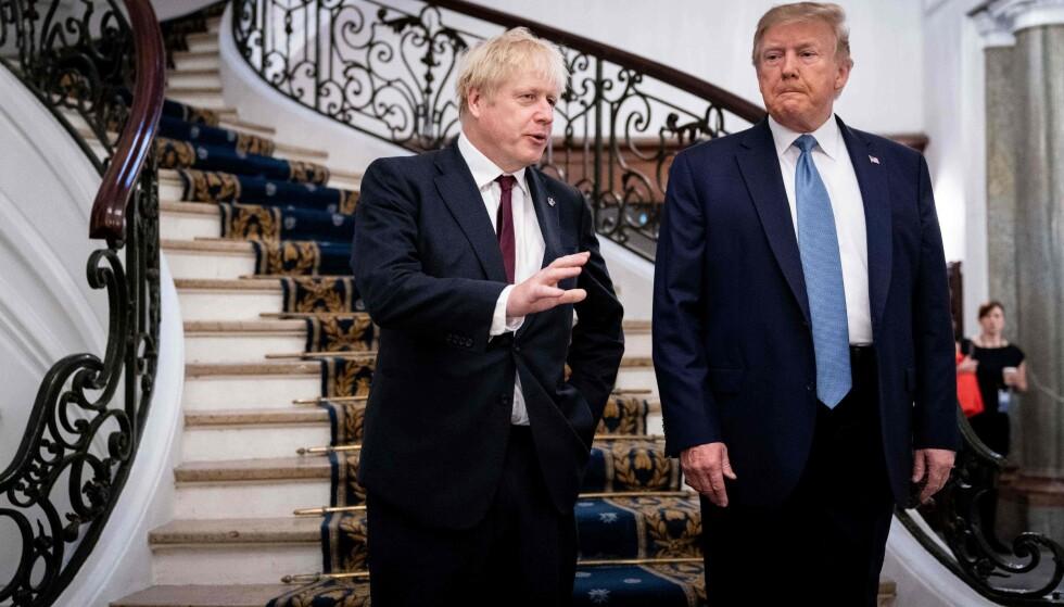 FERDIG: Statsminister Boris Johnson, til venstre, og president Donald Trump før en frokost under toppmøtet Biarritz i Frankrike i august 2019. Den såkalte «bestevennen» er nå «Donald Lame Duck», som det heter i politisk språk i USA når en president sitter på oppsigelse, og dermed er et håp ute for Boris. Foto: Erin Schaff / NTB / AFP