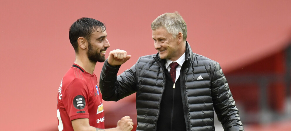 """Soccer Football - Premier League - Manchester United v AFC Bournemouth - Old Trafford, Manchester, Britain - July 4, 2020  Manchester United manager Ole Gunnar Solskjaer and Manchester United's Bruno Fernandes celebrate after the match, as play resumes behind closed doors following the outbreak of the coronavirus disease (COVID-19) Peter Powell/Pool via REUTERS  EDITORIAL USE ONLY. No use with unauthorized audio, video, data, fixture lists, club/league logos or """"live"""" services. Online in-match use limited to 75 images, no video emulation. No use in betting, games or single club/league/player publications.  Please contact your account representative for further details."""