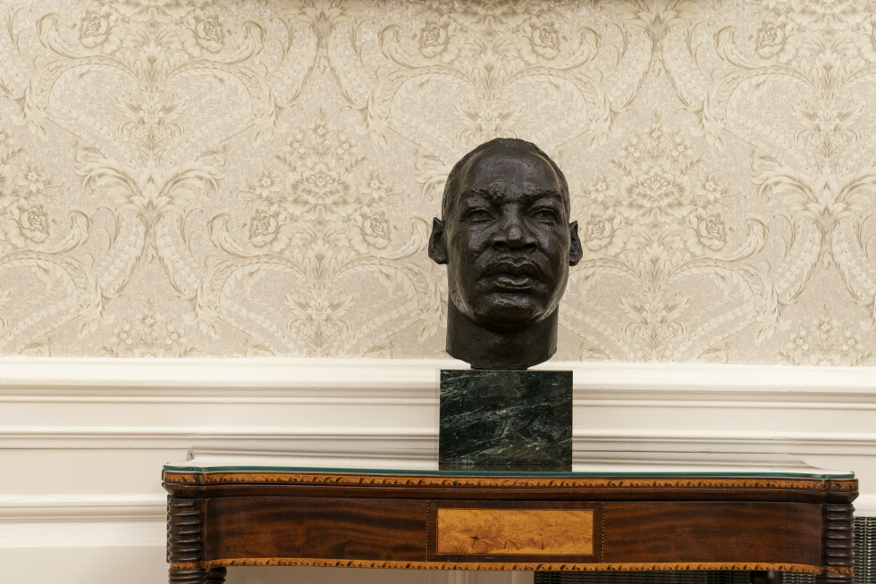 The Oval Office of the White House is newly redecorated for the first day of President Joe Biden's administration, Wednesday, Jan. 20, 2021, in Washington, including a bust of civil rights leader Rev. Martin Luther King Jr.. (AP Photo/Alex Brandon)