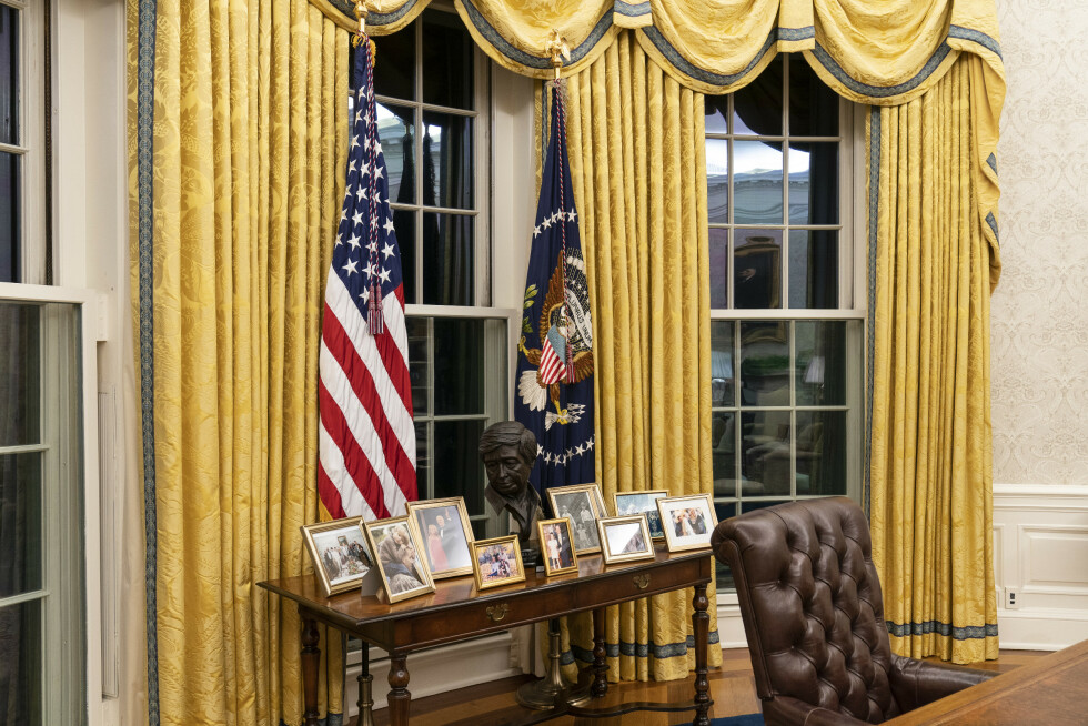 The Oval Office of the White House is newly redecorated for the first day of President Joe Biden's administration, Wednesday, Jan. 20, 2021, in Washington, including a table with family photos. (AP Photo/Alex Brandon)