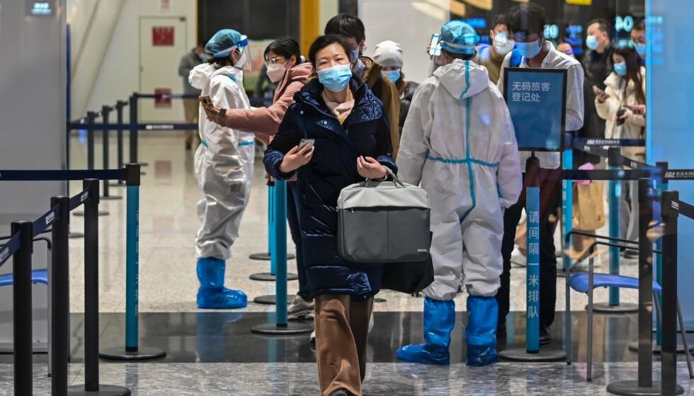 REAGERER: Kina liker dårlig kritikken fra USA. Nå slår de kraftig tilbake. Her fra Tianhe internasjonale flyplass i Wuhan i januar 2021. Foto: Hector Retamal / AFP / NTB