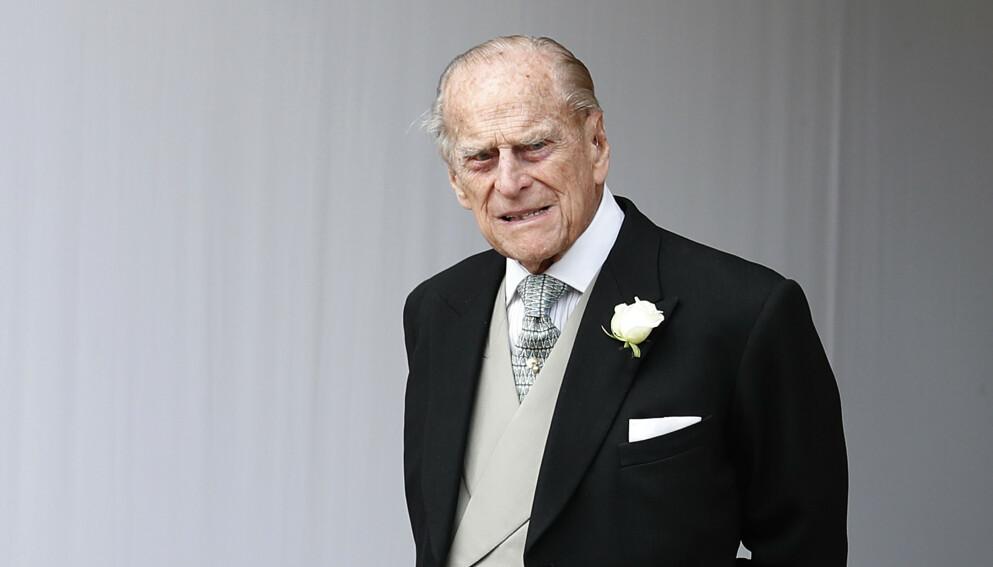 INNLAGT: Prins Philip (99) ble i forrige uke innlagt på sykehus fordi han følte seg uvel. Nå forteller prins William at han har det bra. Foto: Alastair Grant / AP Photo/ NTB