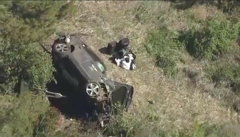 STORE SKADER: Dette er bilen til Tiger Woods etter ulykken. Foto: AP/NTB.